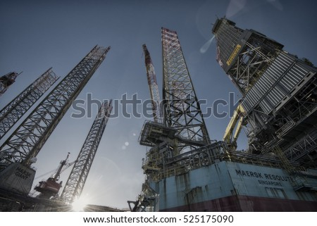 "ESBJERG, DENMARK - NOVEMBER 27 2016: Oil rig ""Maersk Resolute"" and ""Maersk Giant"" from below and sky blue.  November 27 in Esbjerg, Denmark."