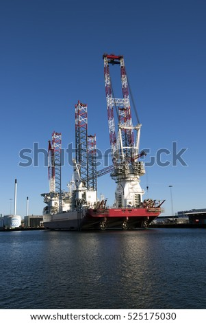 "ESBJERG, DENMARK - NOVEMBER 27 2016: Specialist ship ""Seajacks Scylla"" is the worlds largest and most advanced offshore wind farm installation vessel. November 27 in Esbjerg, Denmark."