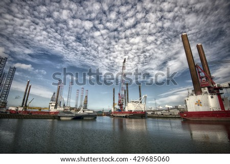 ESBJERG - MAY 28: Esbjerg harbor with windmill equipment and boats. Offshore Construction Jack Up and Offshore wind operations and maintenance. May, 28 2016 Esbjerg, Denmark. - stock photo