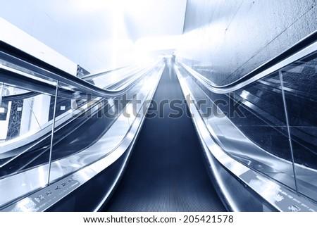 Escalator fast run in metro station - stock photo
