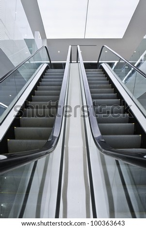Escalator in a modern interior with stainless steel
