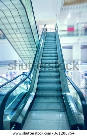 Escalator in a shopping mall - stock photo