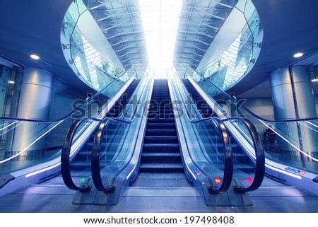 Escalator in airport terminal. No people on moving staircase - stock photo