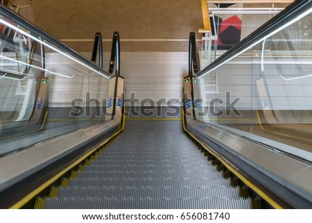 Charming Escalator In Community Mall, Shopping Center Or Department Store. Moving  Staircase. Neon Light