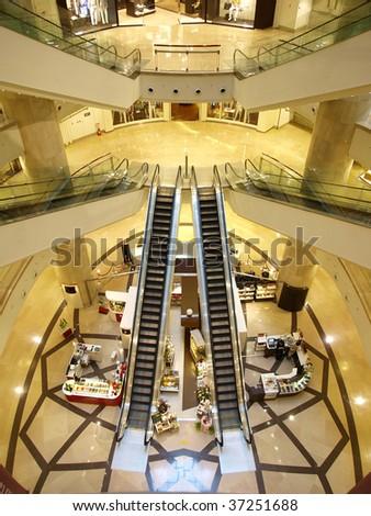 Escalator in department store - stock photo