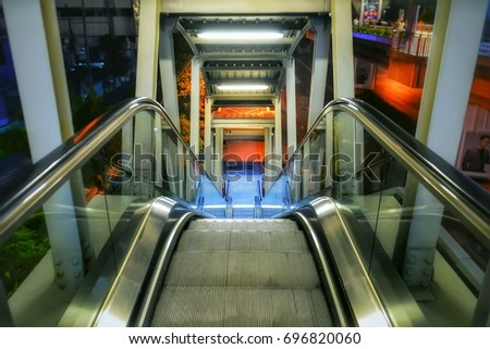 Electric Escalator Moving Up Staircase On Blurred Realistic Background.