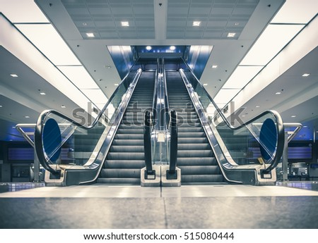 Escalator in modern building. Urban abstract