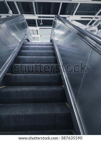 Escalator in modern office building