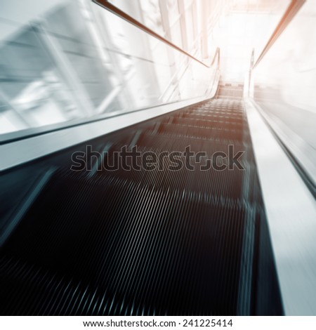 escalator in motion moving fast - stock photo