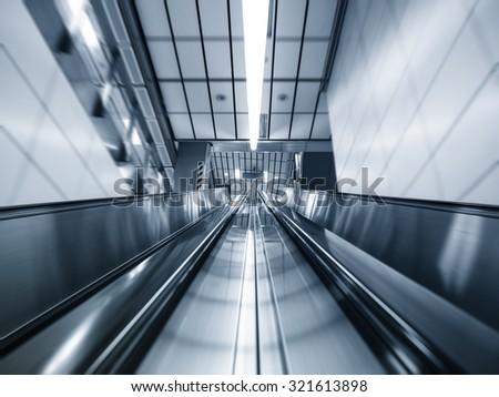 Escalator in subway station Transportation Background - stock photo