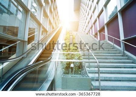 escalator in the outdoor under the sun, urban abstract landscape - stock photo