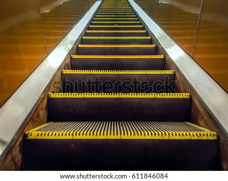 Attractive Moving Staircase. Escalator Up In Metro. City Underground Transportation.