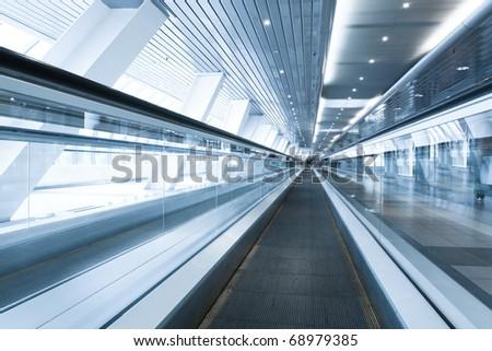 escalator indoor shopping mall - stock photo