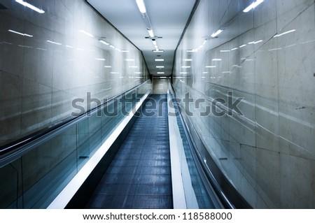Escalator inside metro - stock photo