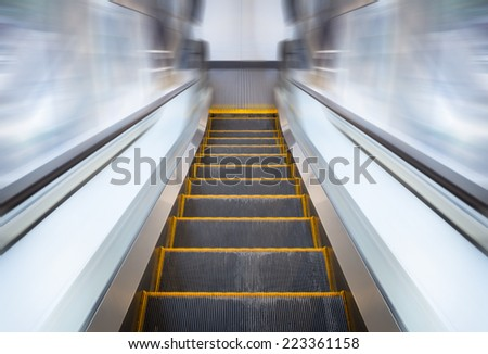 Escalator machine. - stock photo