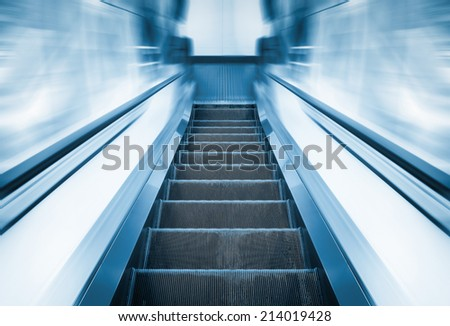 Escalator machine, blue color tone. - stock photo