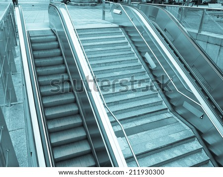 Escalator stairs to an underground station or supermarket - cool cyanotype