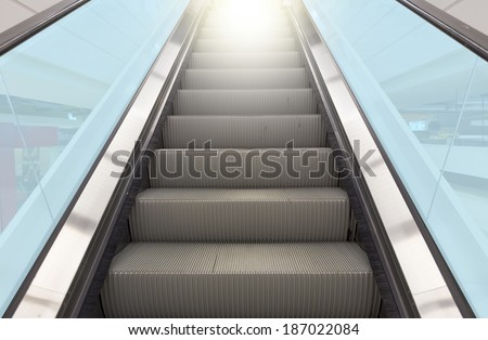 Escalator with blue glass.  - stock photo