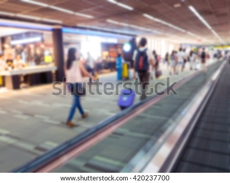 escalator with traveler in motion blur in airport.
