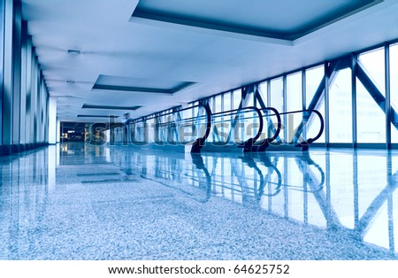 Escalators in modern business center. Tint blue - stock photo