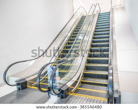 Escalators in the hallway of the hospital.