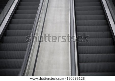 Escalators in train station (Liege, Belgium) - stock photo
