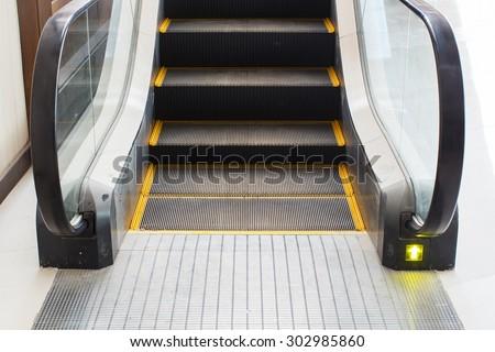 escalators stairway, arrow light for up - stock photo