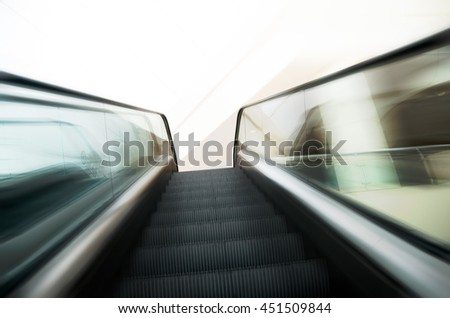 Escalators stairway zoom speed motion effect - stock photo