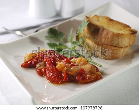 Esgarraet � Red pepper & cod Salad. �Esgarrat� or �esgarraet�,  is a typical Valencian dish served as starter or appetizer, and made with grilled red pepper, cured-salted cod, garlic, and olive oil.