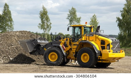 Eskilstuna, Sweden, June 25, 2015: Loader Volvo L 180H work, Volvo Days 2015, Eskilstuna - stock photo