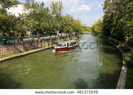 ESKISEHIR, TURKEY - SEPTEMBER 03, 2016: Boat tour in Porsuk river. Porsuk river is one of the most populer touristy place with boat tours and entertainment in Eskisehir.