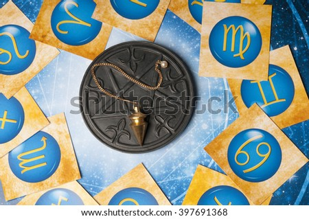 esoteric table with astrology and divination objects - stock photo