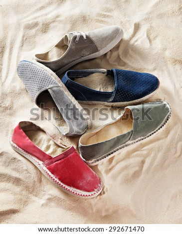 espadrilles shoes composition in sand - stock photo