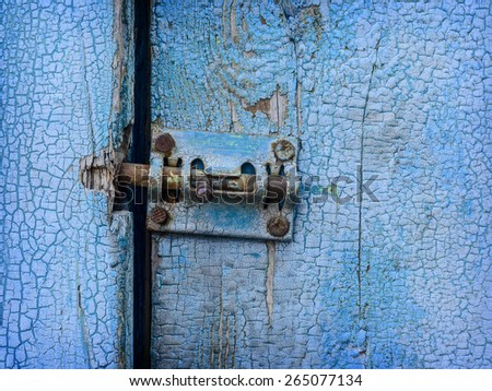 Espagnolette on old blue painted door close up - stock photo