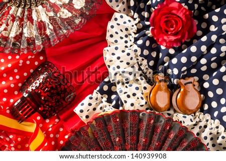 Espana typical from Spain with castanets rose fan and flamenco comb and dress - stock photo