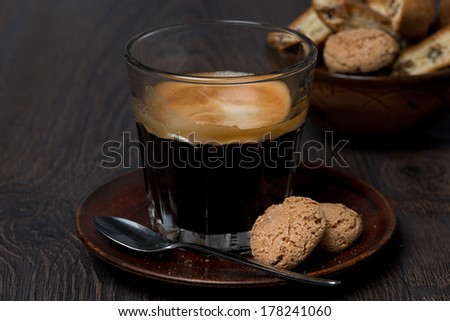 espresso and almond cookies on dark background, close-up - stock photo