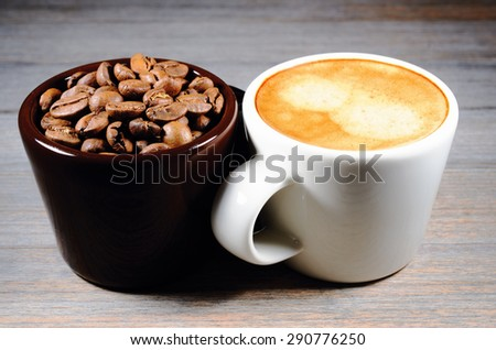espresso and cup of coffee beans on wood - stock photo
