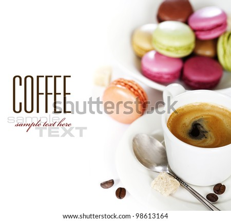 Espresso and fresh colorful macaroons (with sample text) - stock photo