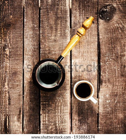 Espresso Coffee cup and Coffee pot over wood table top view. Inspirational early morning breakfast. - stock photo