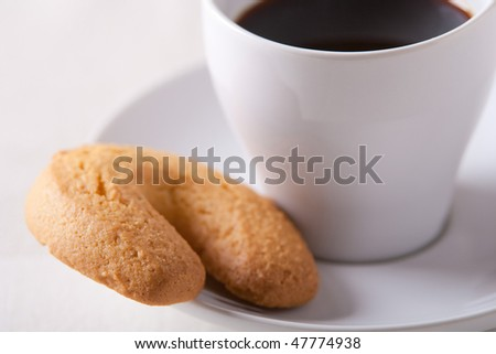 Espresso coffee cup with a biscuit on the saucer - stock photo
