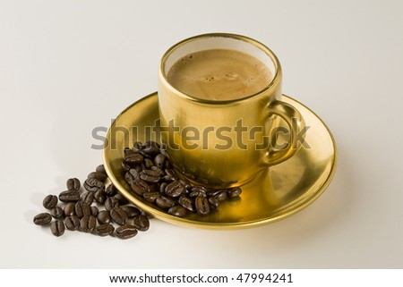 Espresso coffee cup with beans on white - stock photo