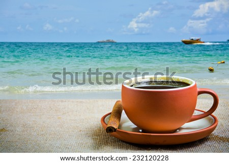 Espresso coffee cup with sea background  - stock photo