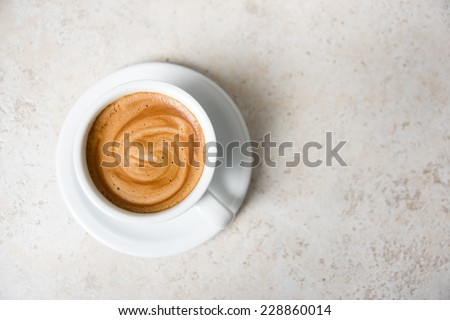 Espresso Coffee Drink in Simple White Mug on Stone Counter top - stock photo