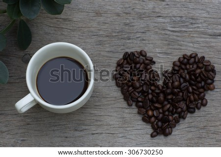espresso coffee in a white cup  on old wood background - stock photo