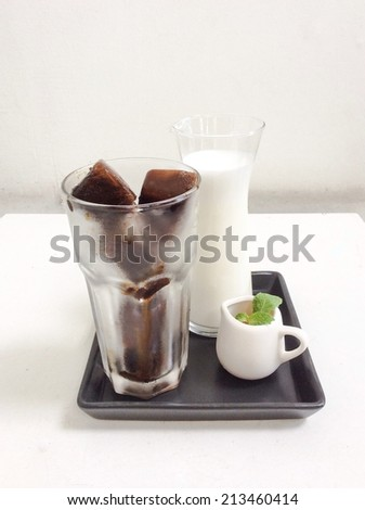 Espresso coffee in ice-cube shape with steam milk latte cappuccino and syrup