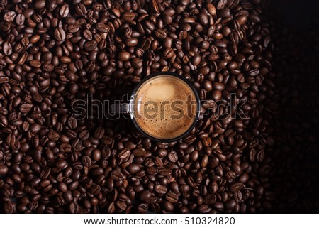 espresso coffee on coffee beans background