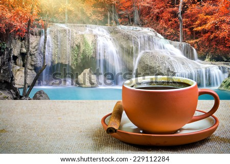 Espresso coffee with waterfall background  - stock photo