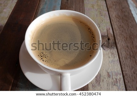 espresso cup of coffee on wood table