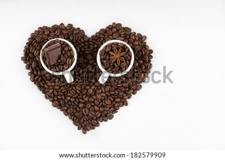 espresso cups filled with coffee beans