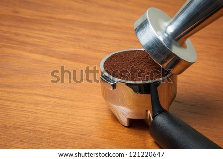 Espresso filter on wooden table